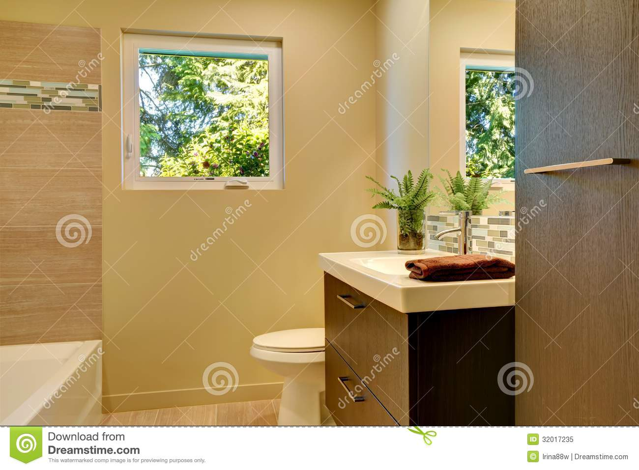 Beige modern new bathroom with brown wood cabinets and tub royalty free stock photo image Beige brown bathroom design