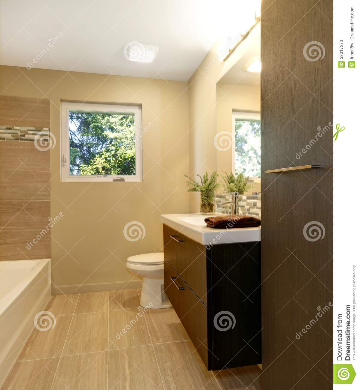 Beige Modern New Bathroom With Brown Wood Cabinets And Tub