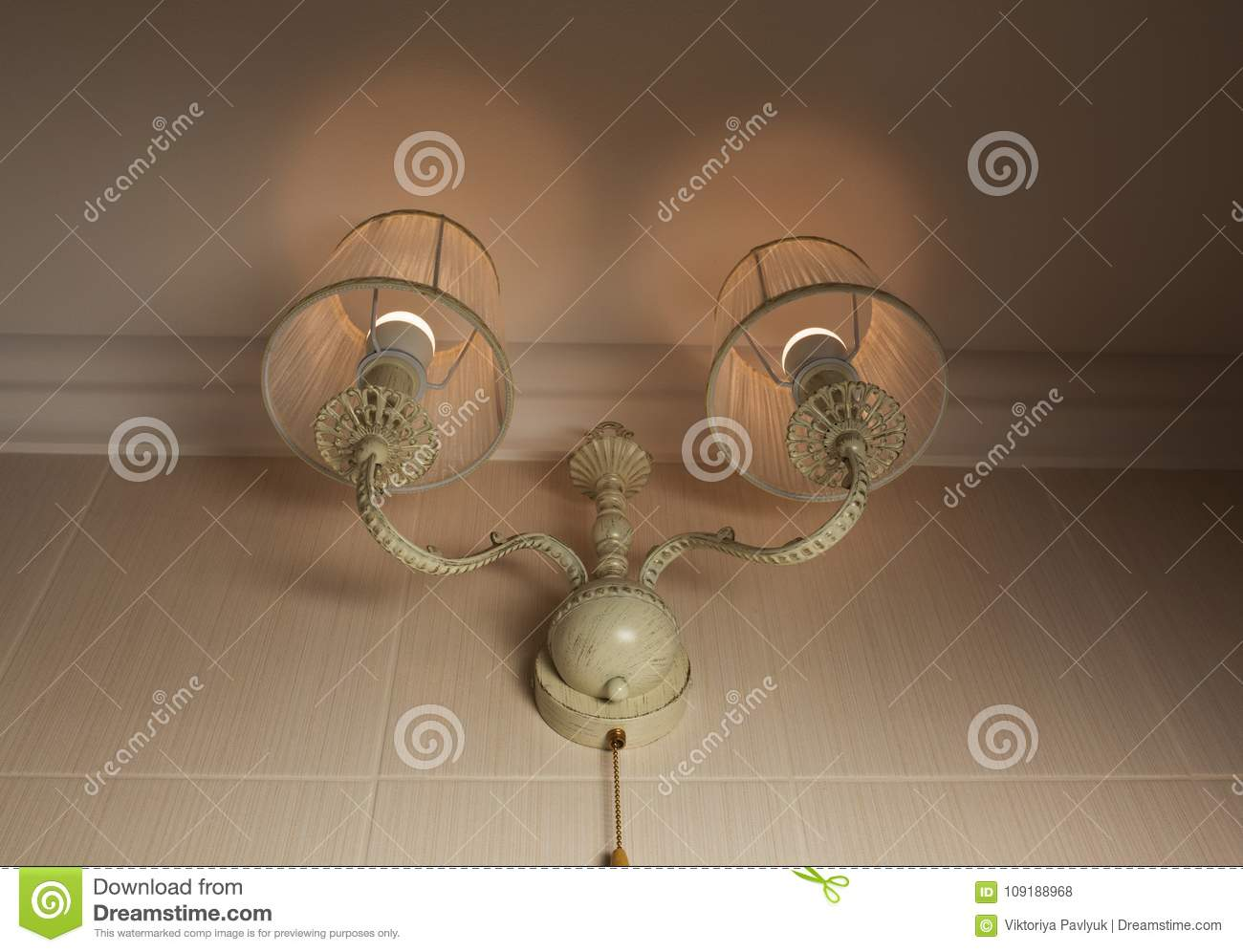 Beige Old Fashioned Lamp On The Wall With Light Flares Stock Photo ...