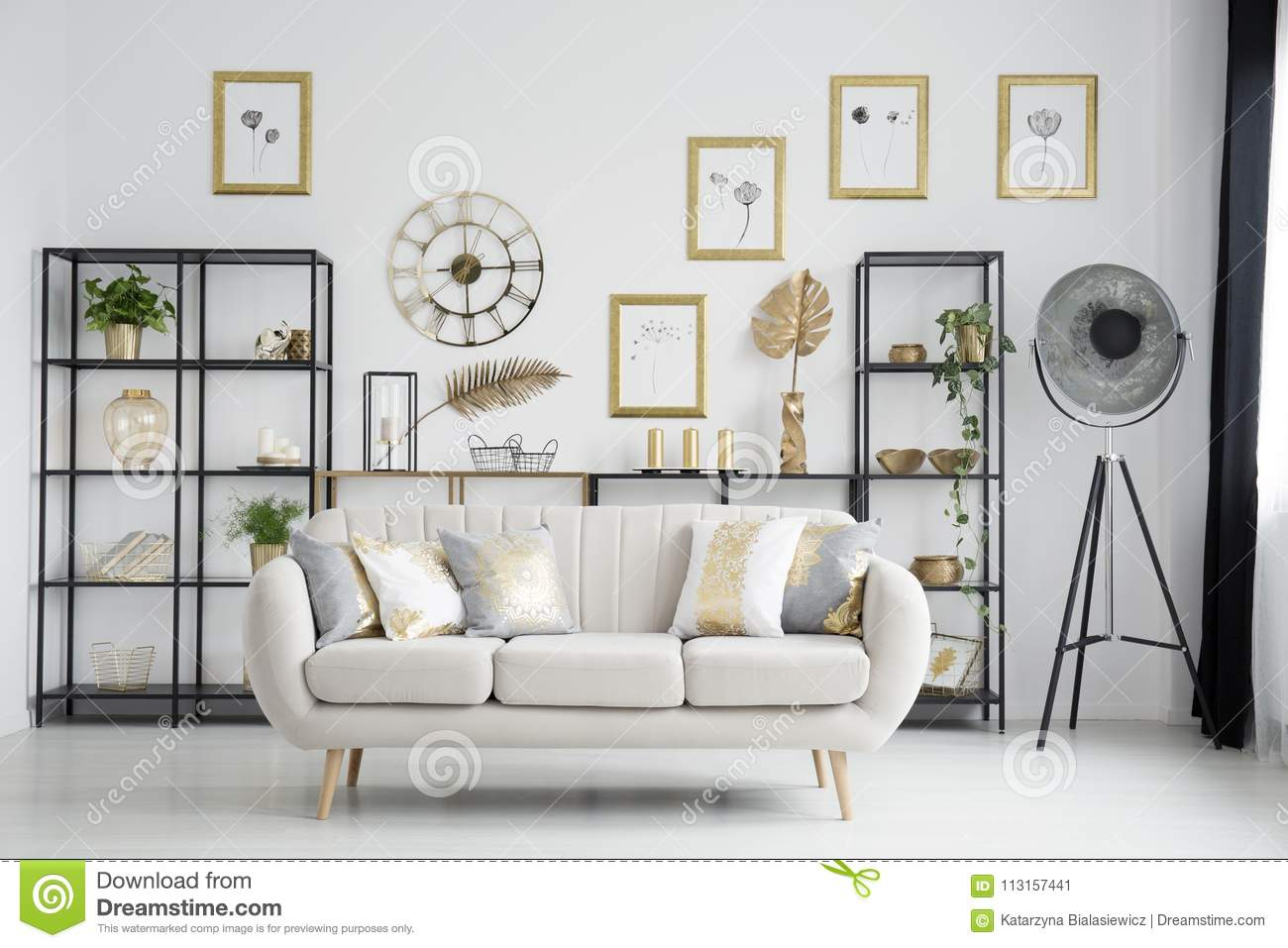 Sofa in gold living room stock image. Image of gallery - 113157441