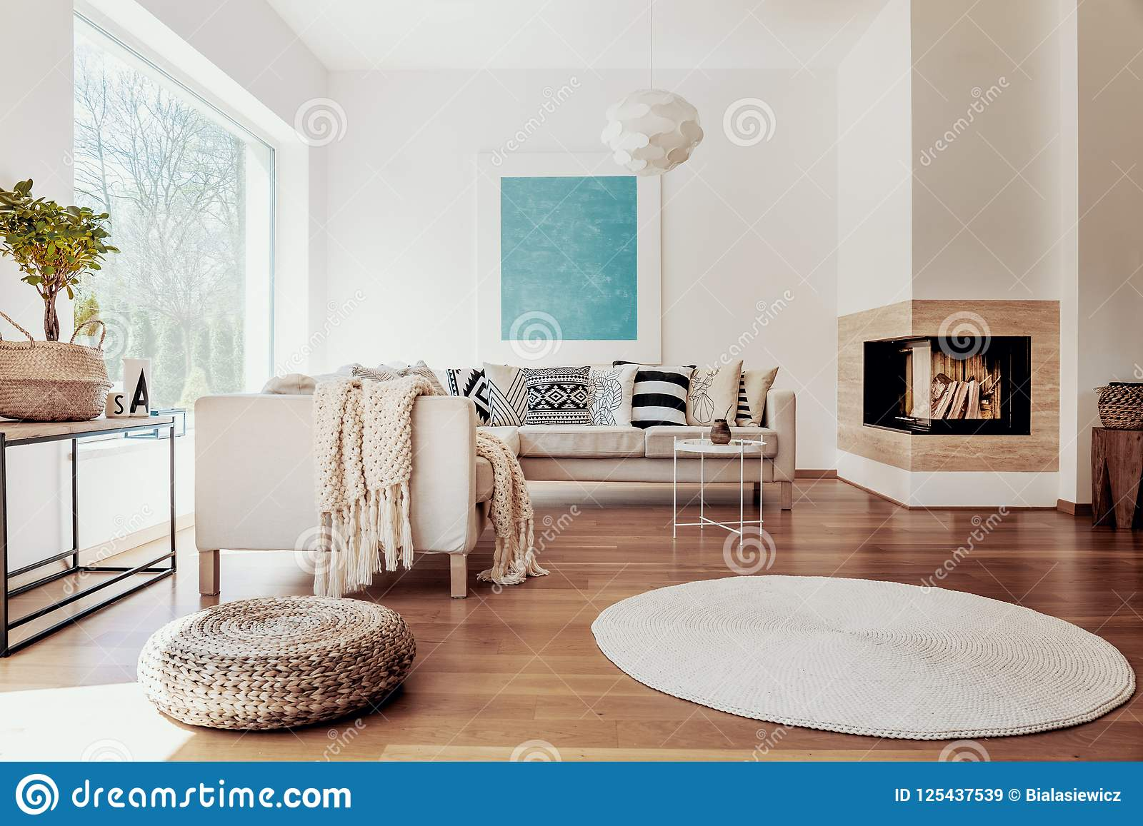 Beige And White Textiles And A Modern Spherical Pendant