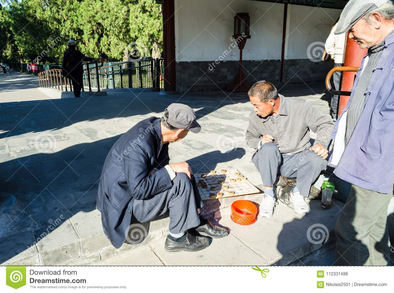 BEIJING, CHINA – October 15, 2013: men playing checkers Xiangqi - the Chinese national board game