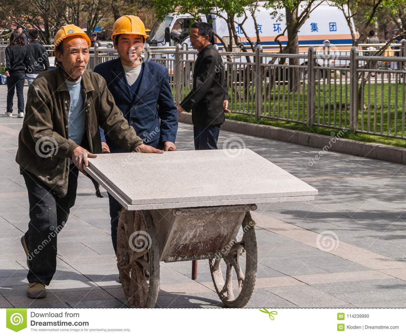 Workers Push Cart With Stone Slabs, Beijing China  Editorial Image