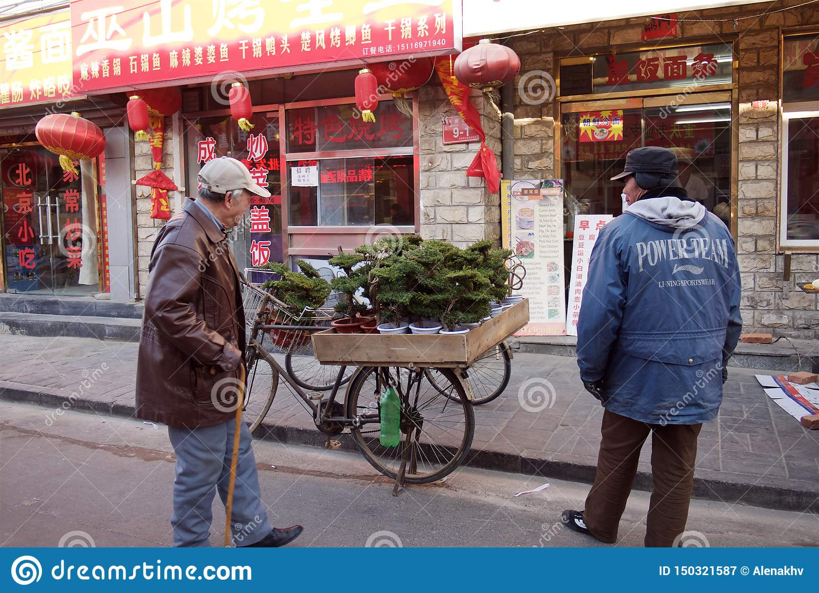 Beijing, China - January 10, 2011: man sells bonsai trees in the street of Beijing