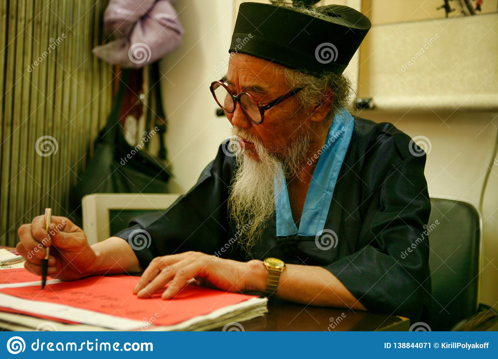 Beijing China - June 8, 2018: Chinese predictor and astrologer makes horoscope for the tourist.