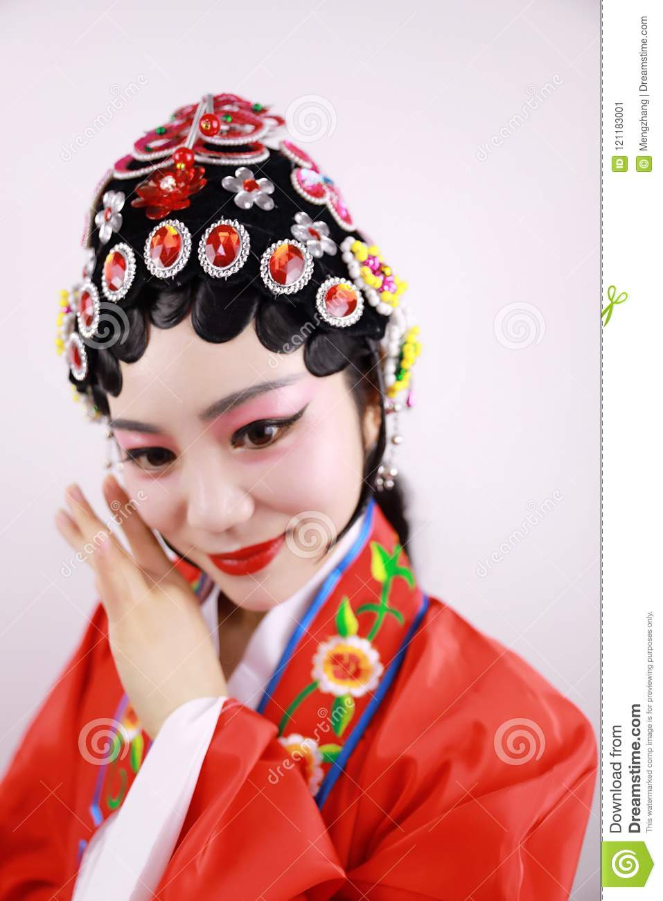 Beijing opera female actor with traditional headwear making up, getting ready for performance Traditional Beijing opera actress in traditional costume ...