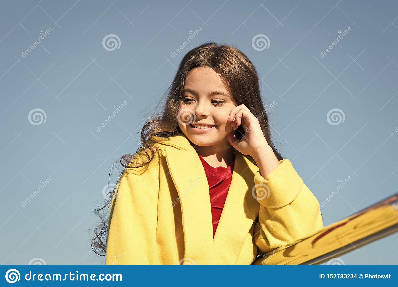 Being proud of her hair. Little child with stylish long brunette hair. Fashion look of hair model. Small girl with