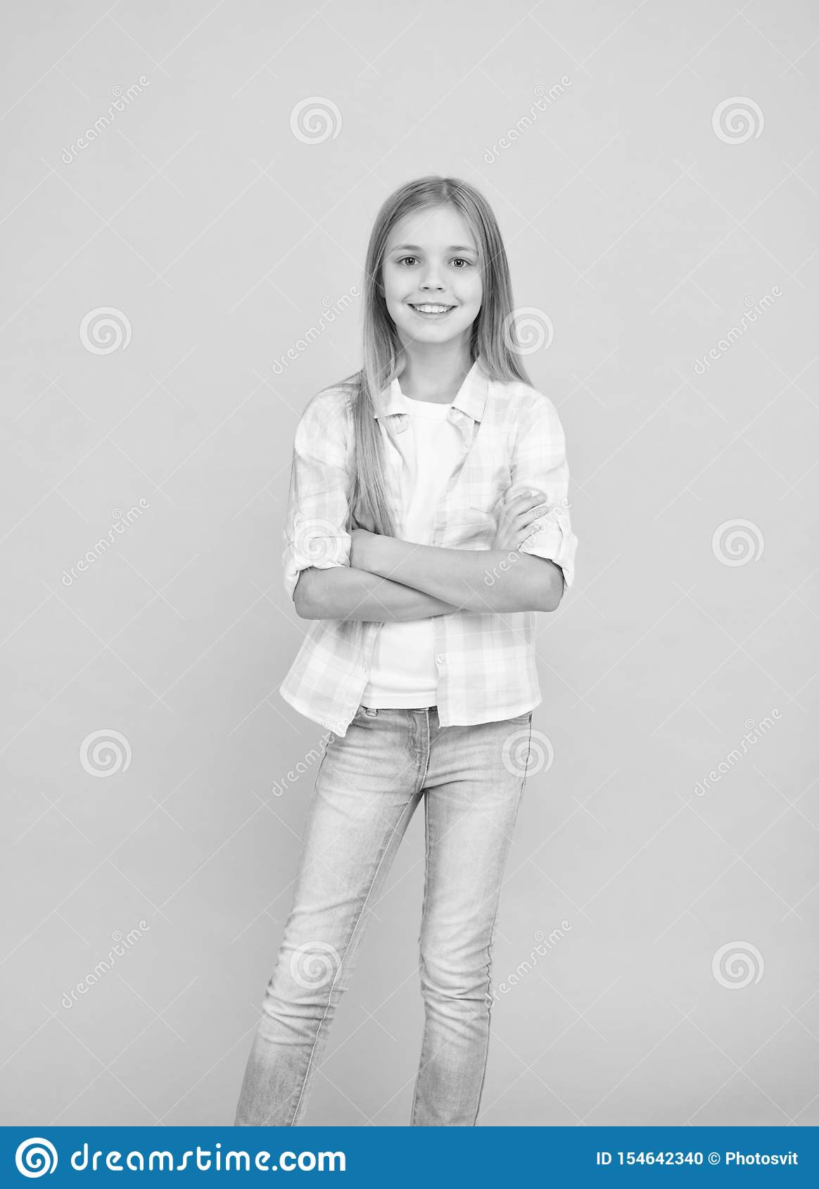 Being used to model clothes. Small child wearing casual style. Fashionable little girl child. Little girl with long