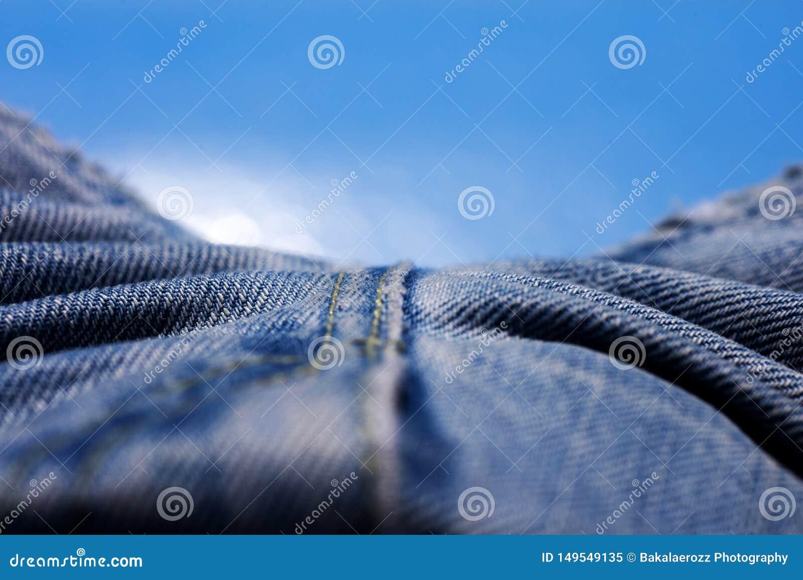 Belas artes macro extremas do fundo das fibras da roupa de cal?as de ganga nos produtos de alta qualidade 50,6 Megapixels das c?p
