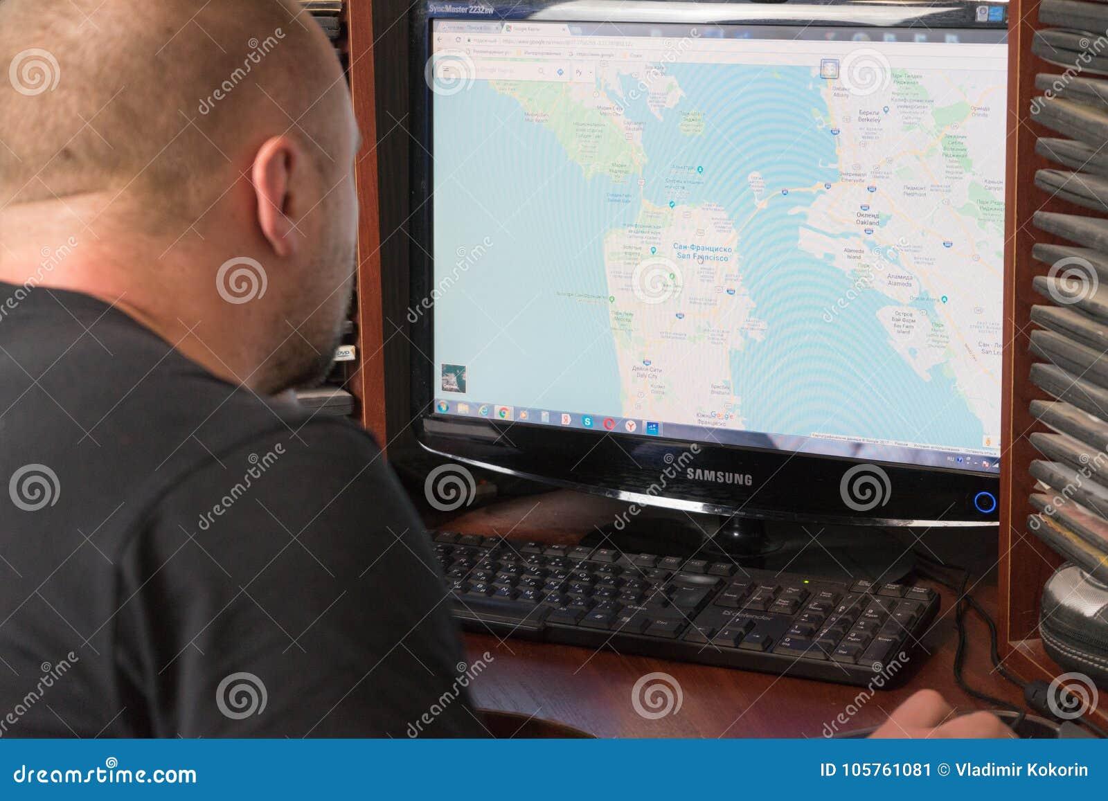 Belgorod, Russia - December 11, 2017: Man Uses Google Maps ... on download london tube map, topographic maps, online maps, download business maps, download icons, download bing maps,