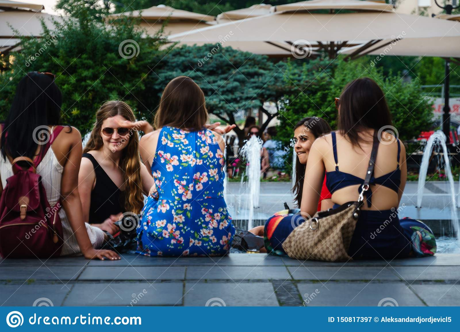 Belgrade,Serbia-June 10, 2019: Girls chatting near the fountain in the center