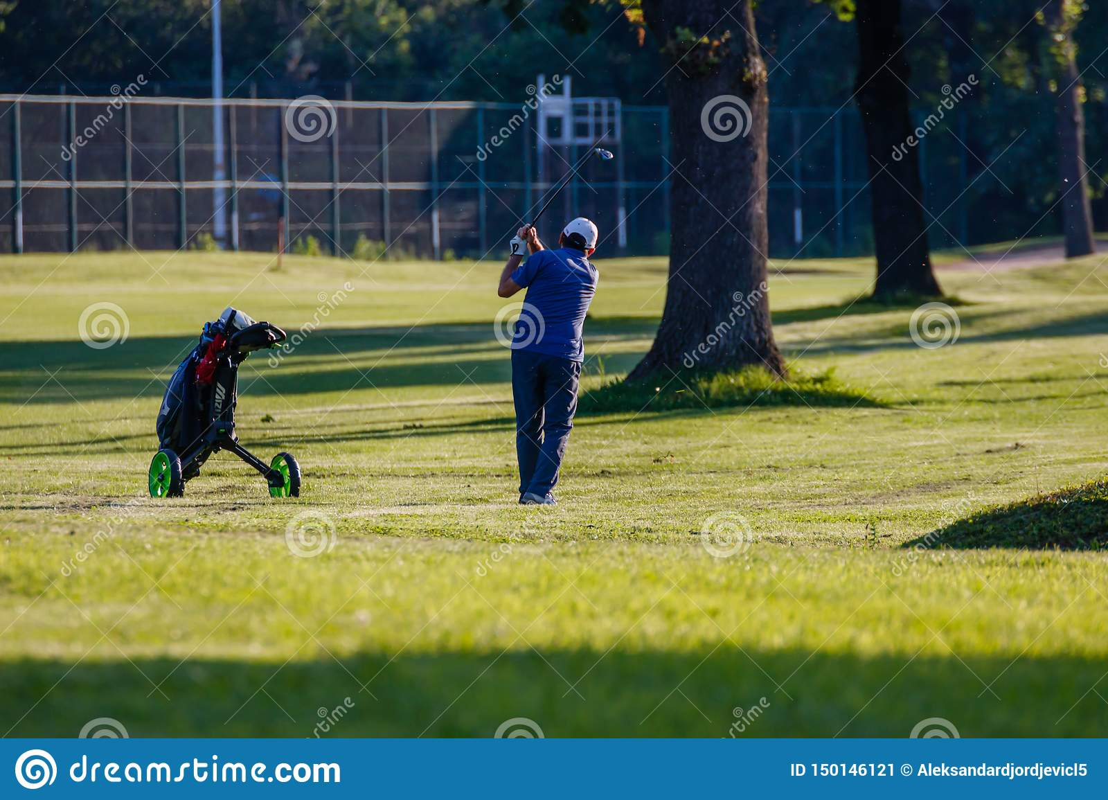 Belgrade, Serbia- June 1, 2019: Senior golfer at the golf course, just hit the ball
