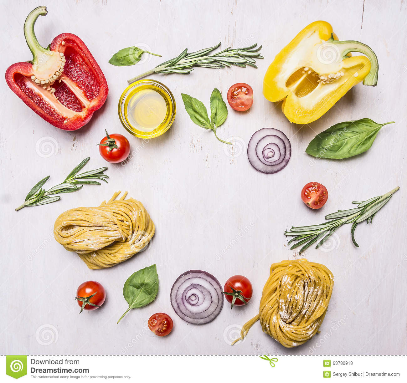 Bell peppers, oil, rosemary, cherry tomatoes and other ingredients for cooking vegetarian pasta, lined frame wooden rustic back