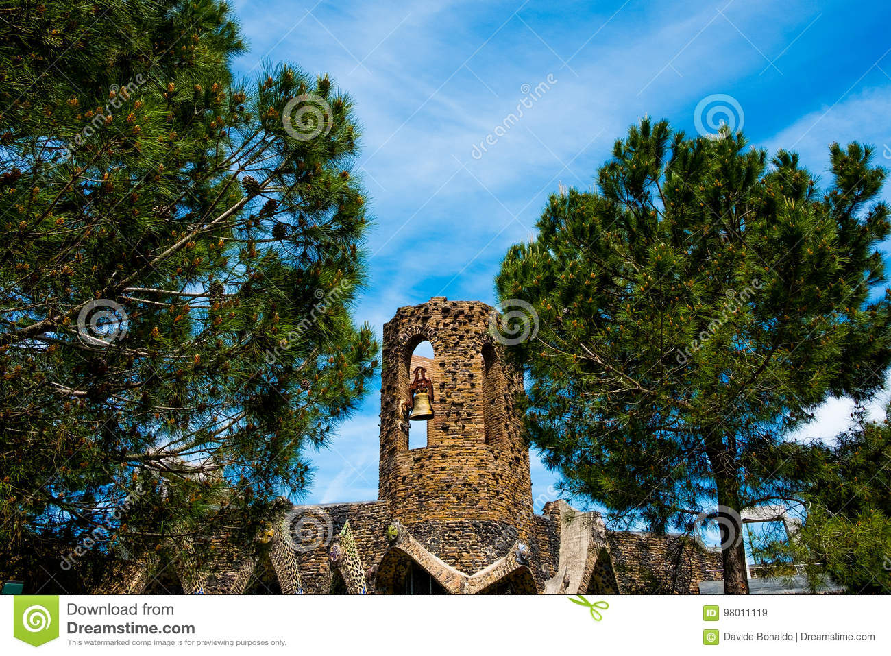 Bell tower of antoni gaudi colonia guell church in catalonia in sunny day