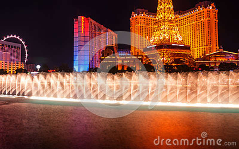 Bellagio`s famous fountain with Paris Las Vegas hotel in background
