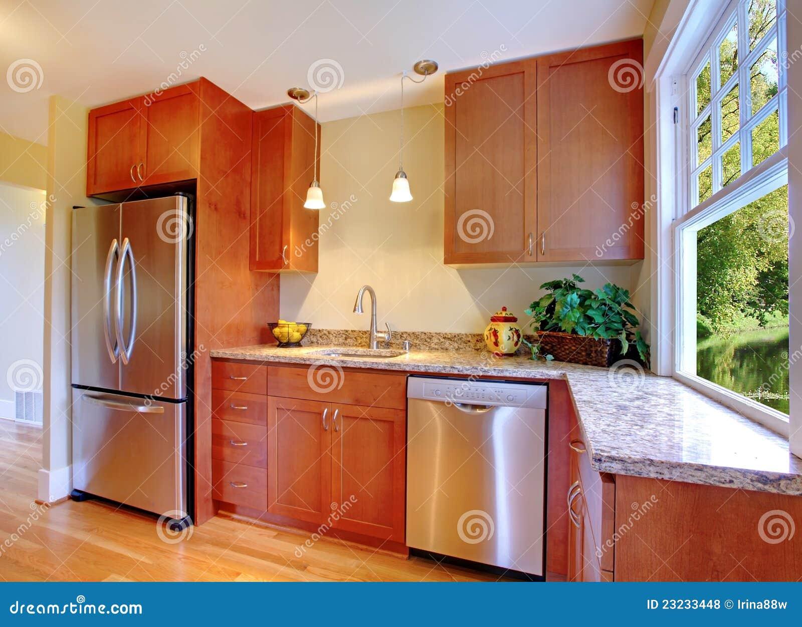 belle cuisine neuve de cerise avec le bois dur photos libres de droits image 23233448. Black Bedroom Furniture Sets. Home Design Ideas