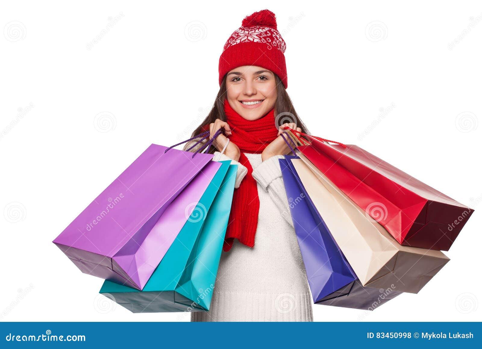 Belle femme heureuse étonnée tenant des paniers dans l excitation Fille de Noël en vente d hiver, d isolement sur le fond blanc