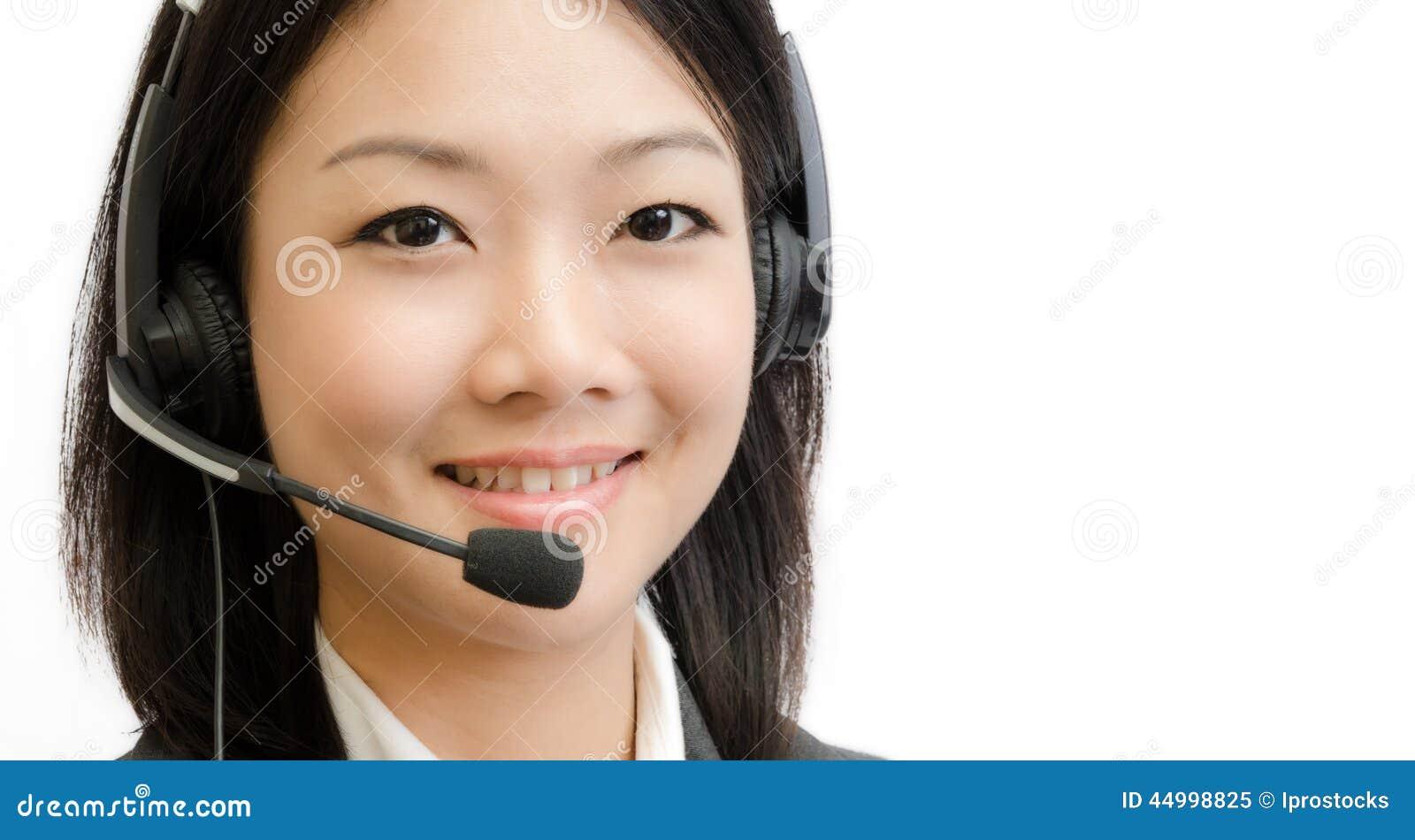 Belle jeune femme d affaires de l Asie avec l écouteur
