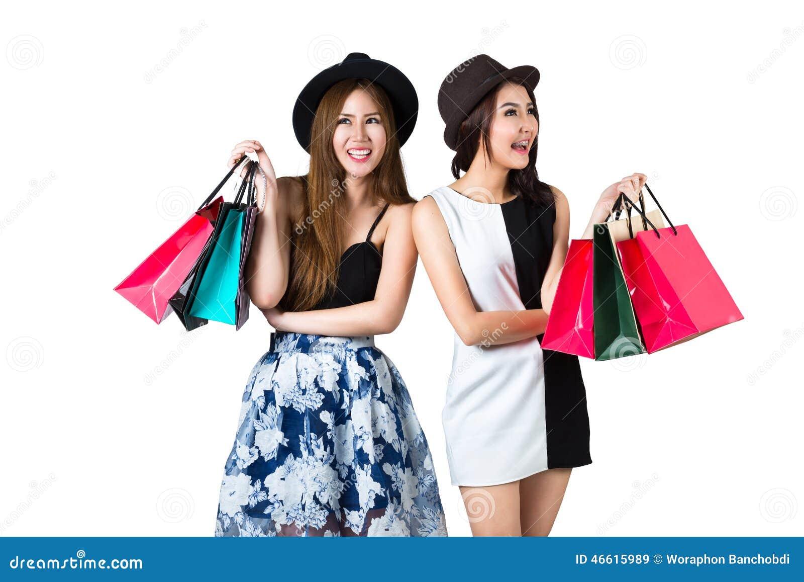 Belles filles de l adolescence asiatiques portant des paniers