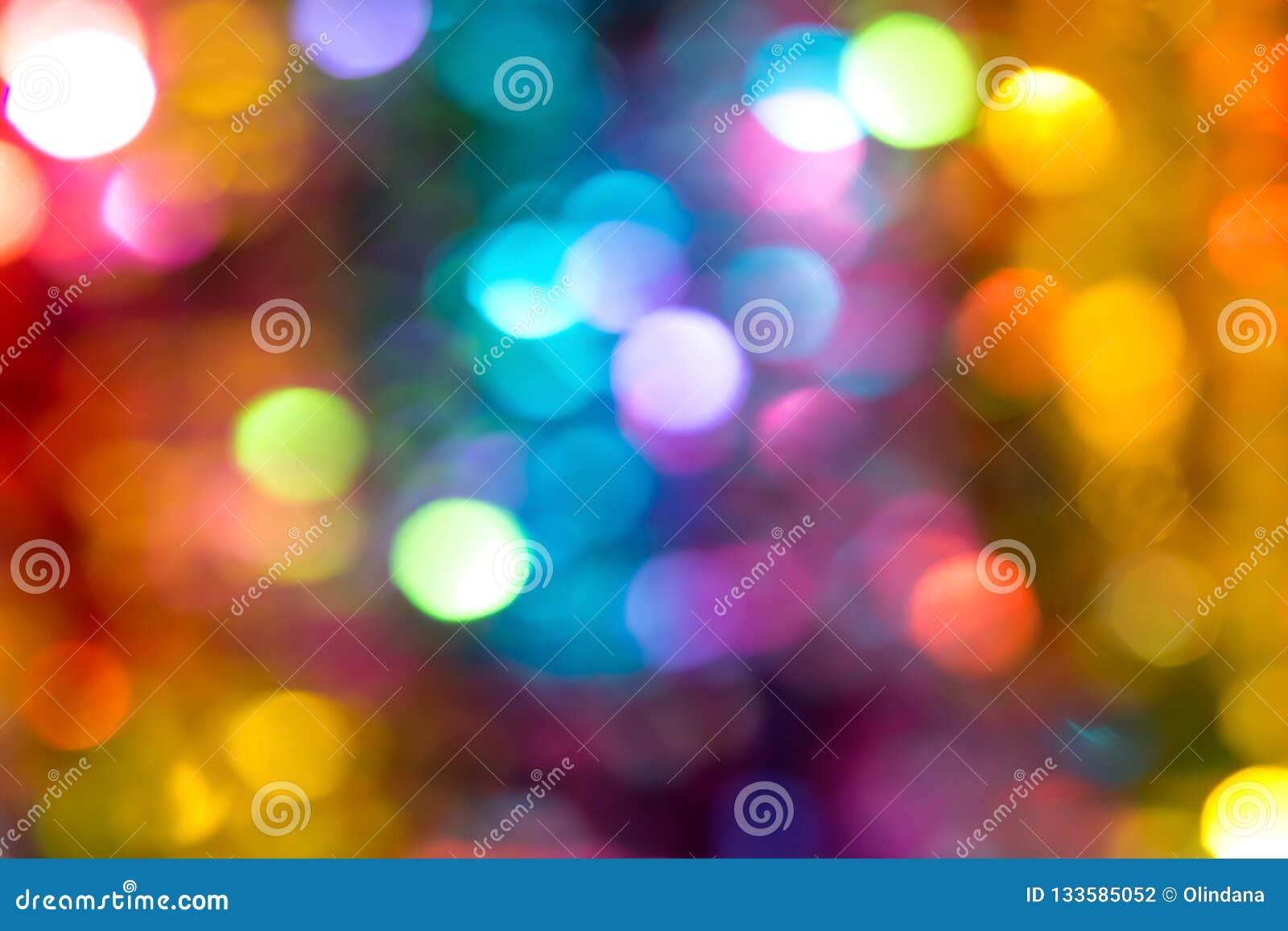 Bello fondo multicolore di scintillio di festa delle luci del bokeh per la celebrazione di compleanno del nuovo anno di Natale