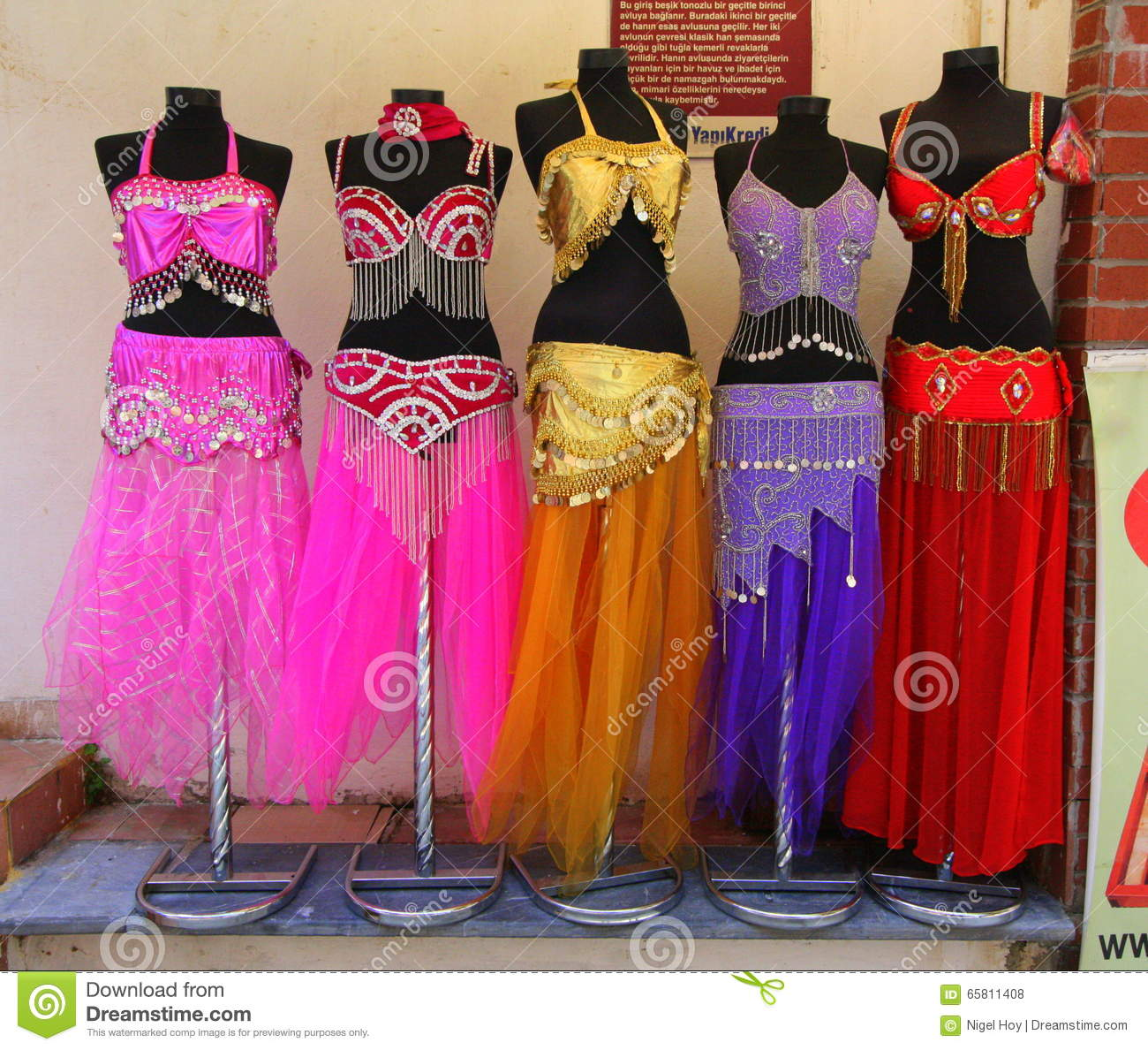Belly Dancer Costumes On Stands Editorial Stock Photo - Image of