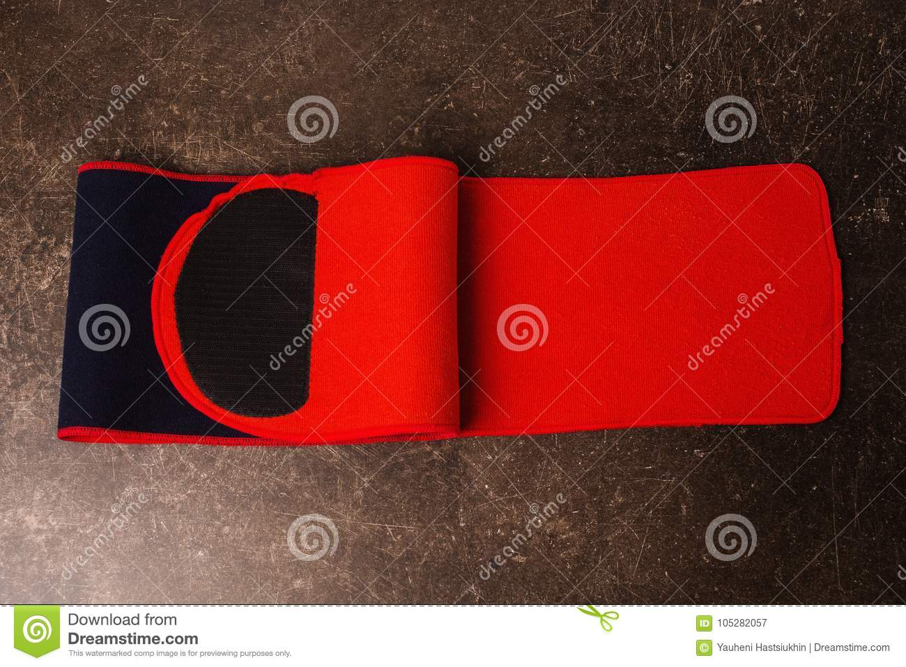 Belt for weight loss on a dark marble background.