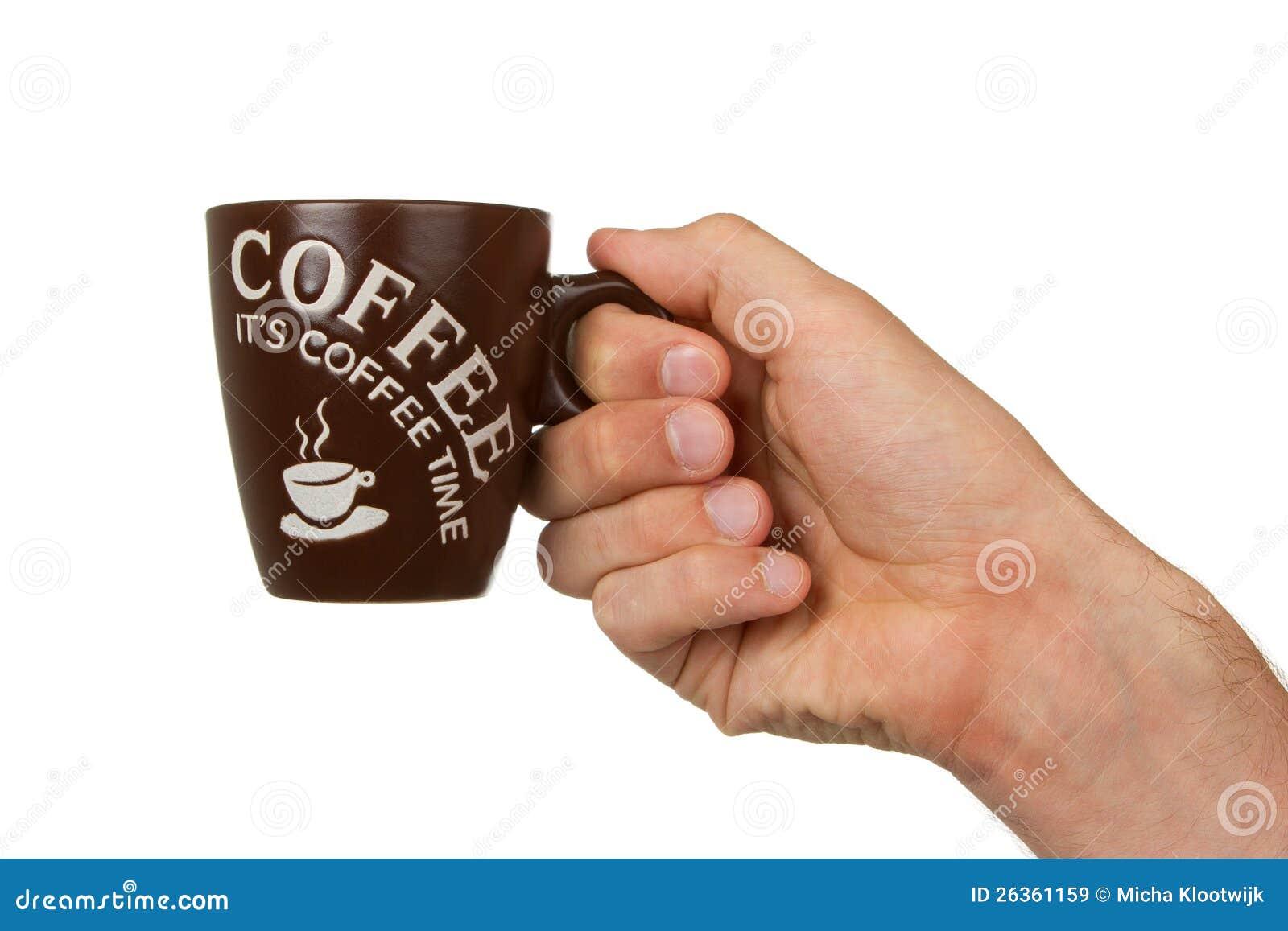 Bemannen Sie das Halten eines Tasse Kaffees