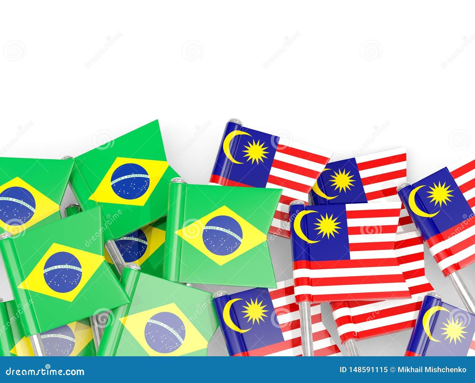 Ben med flaggor av Brasilien och Malaysia som isoleras på vit