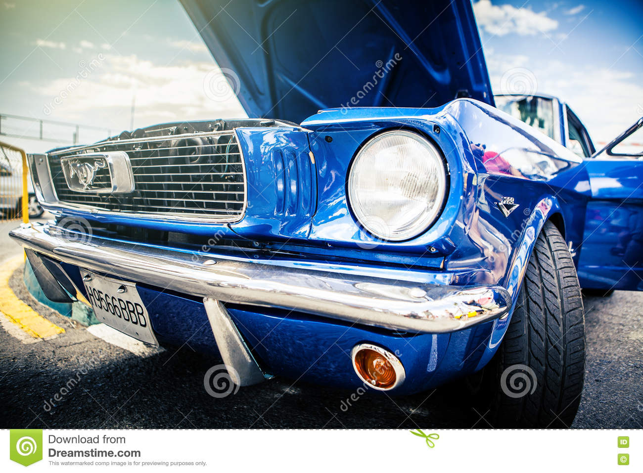 Benalmadena, Spain - June 21, 2015: Front view of classic Ford Mustang in blue color.