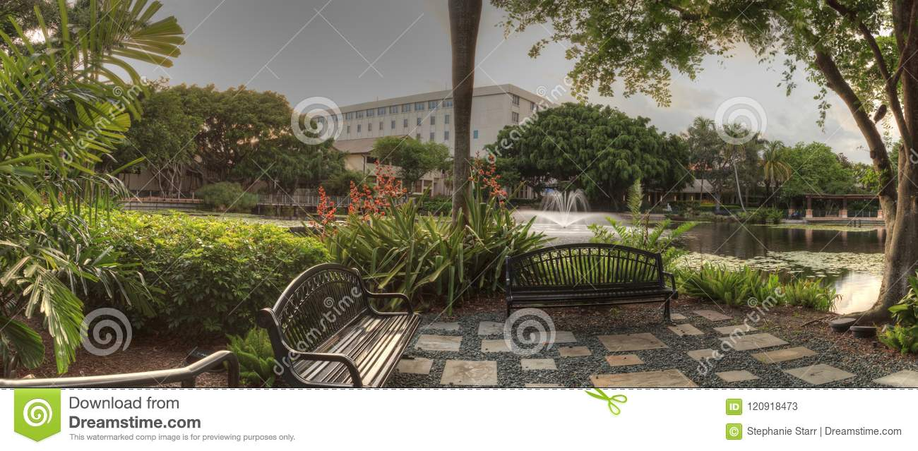 Bench Overlooking A Pond At The Garden Of Hope And Courage Editorial ...