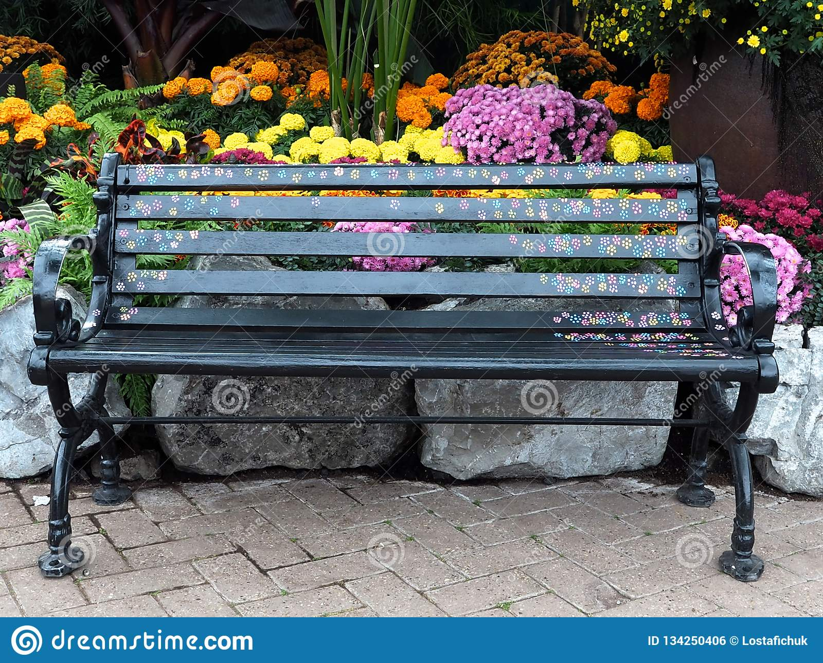 Painted Bench With Flowers In Greenhouse