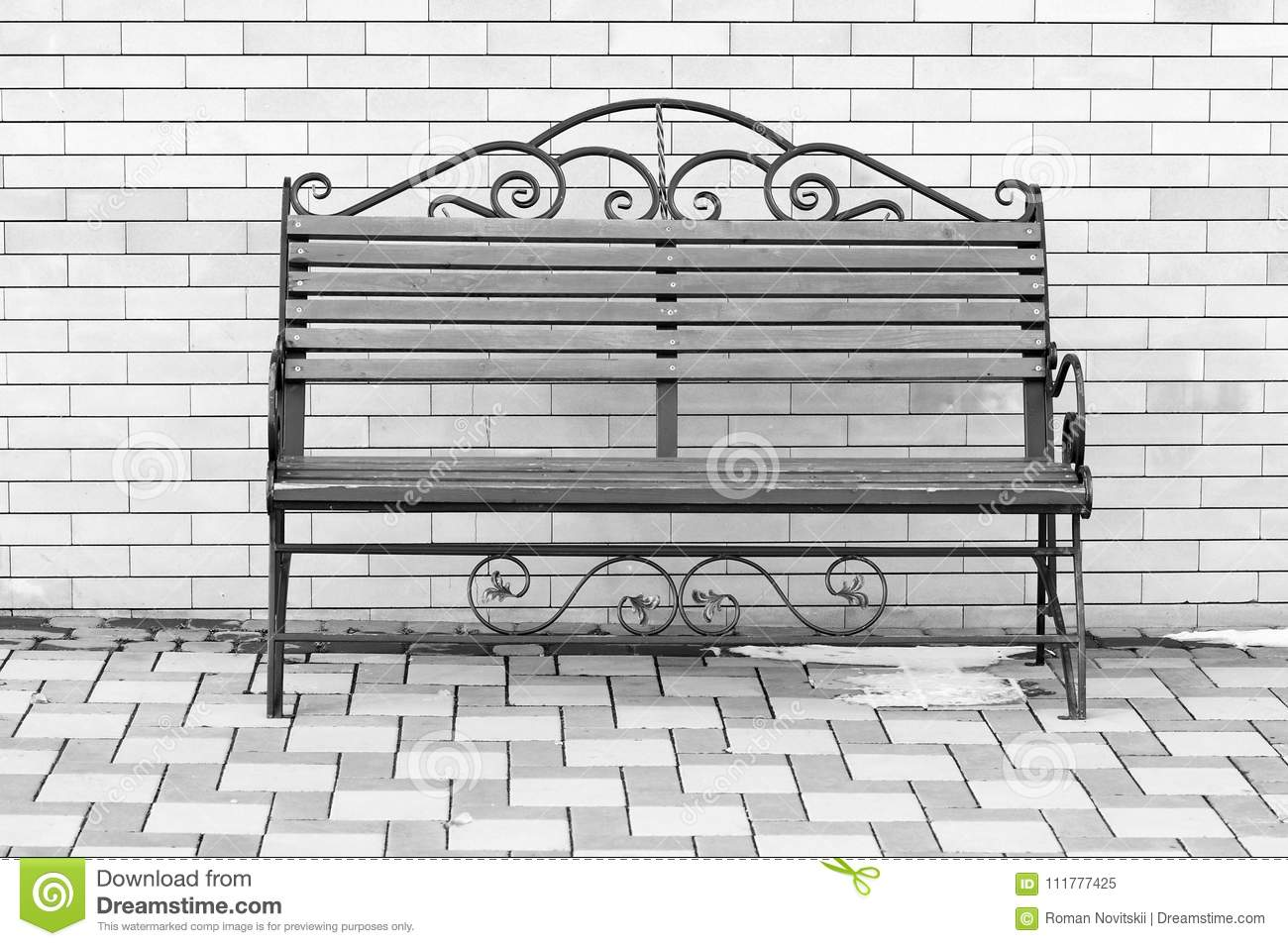 Bench in Park on a background of brick walls. Black and white image.