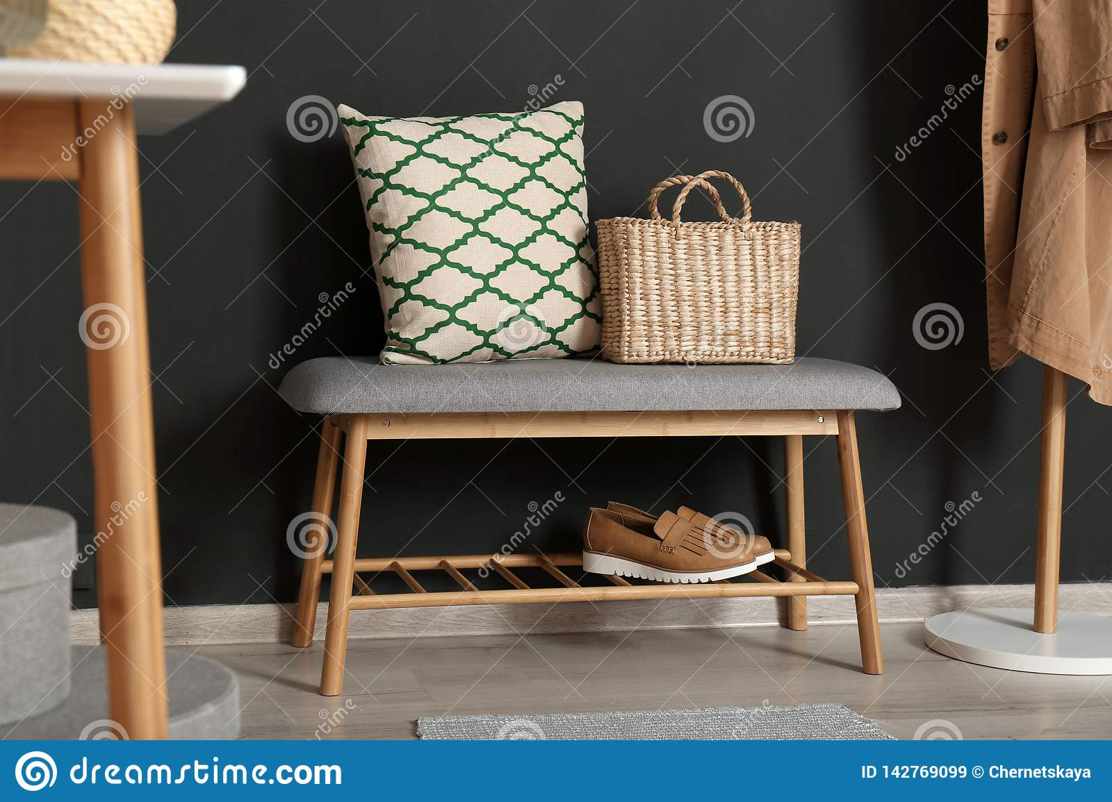 Fine Bench With Pillow And Bag At Black Wall Stock Image Image Caraccident5 Cool Chair Designs And Ideas Caraccident5Info
