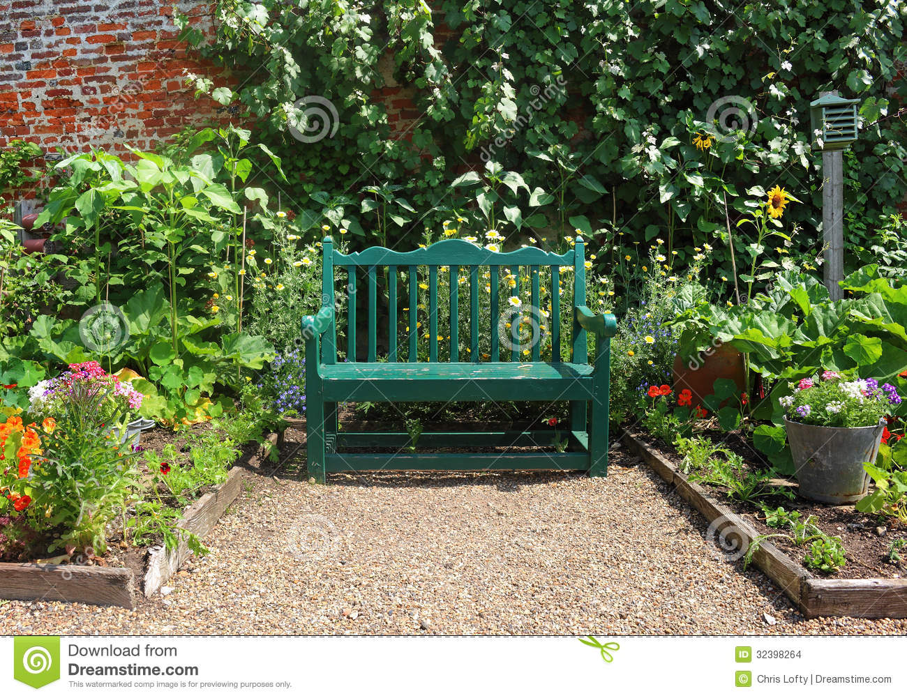 Bench Seat In An English Garden In Early Spring Stock