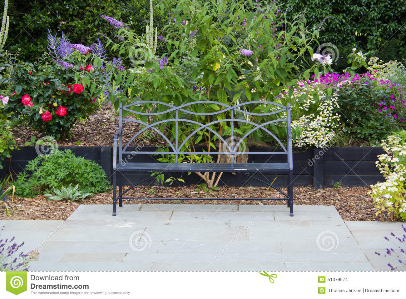 Bench seat on garden patio with flowers stock photo image 51379974 - Flowers planted may complete garden ...