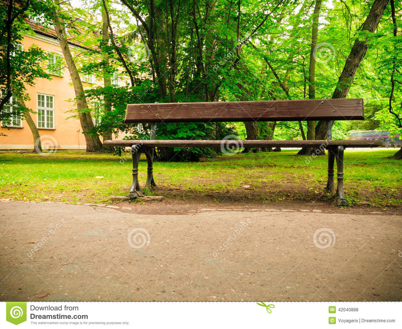 Relax. Empty wooden brown bench on sidewalk walking pavement in park ...