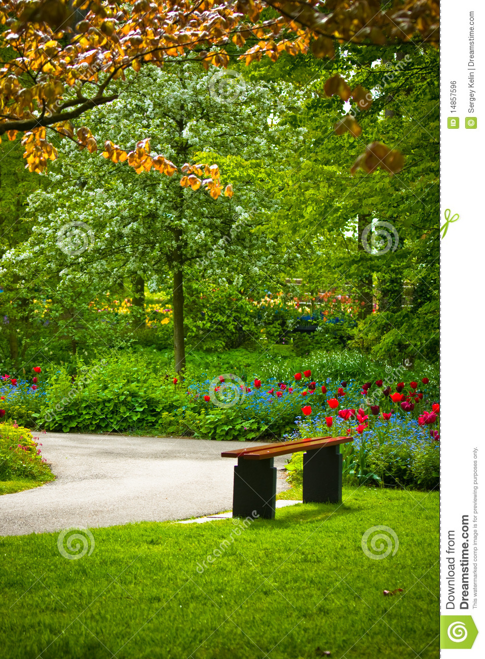 ... similar stock images of ` Bench under a tree with flowers in a park