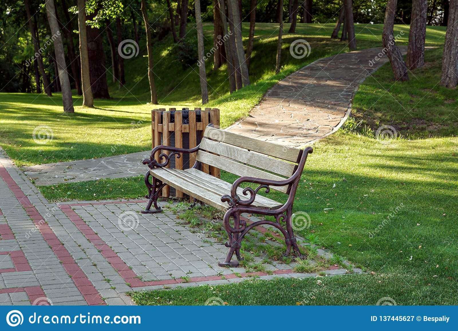 Awesome A Bench With A Wooden Seat And Iron Forged Legs Stock Image Inzonedesignstudio Interior Chair Design Inzonedesignstudiocom