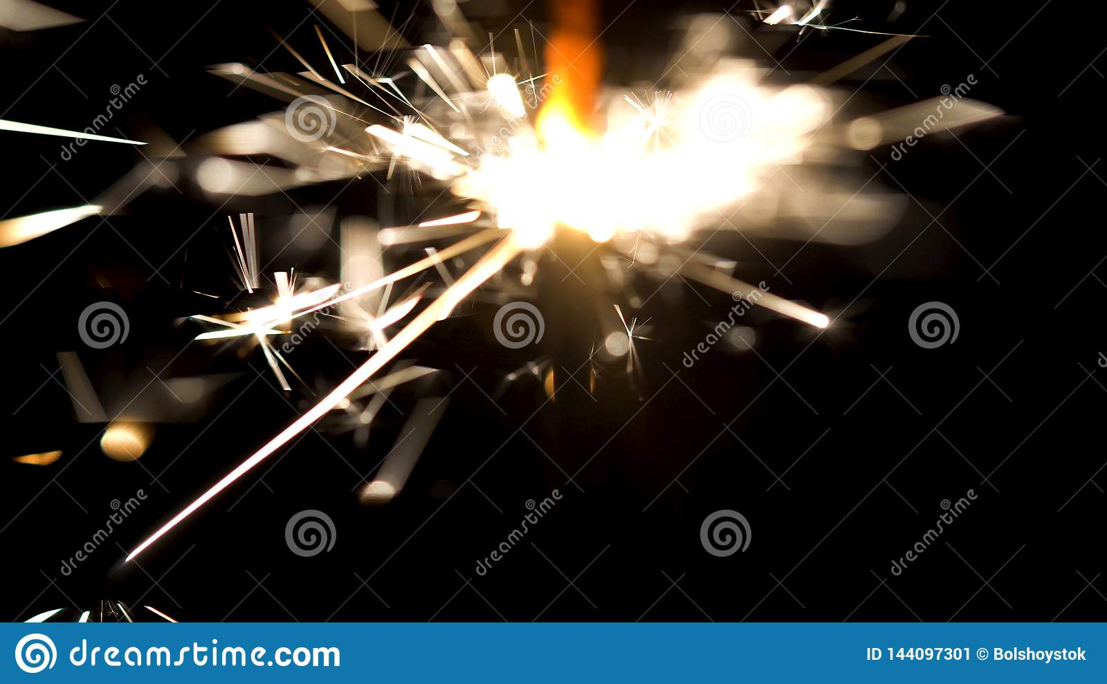 Bengal fire with beautiful sparkles isolated on black background. Media. Burning sparkler in the dark, Merry Christmas