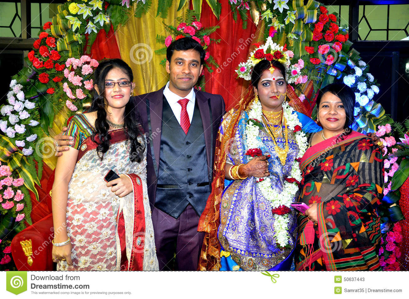 Bengali community beautiful indian couple with relatives during the marriage ceremony stock photos