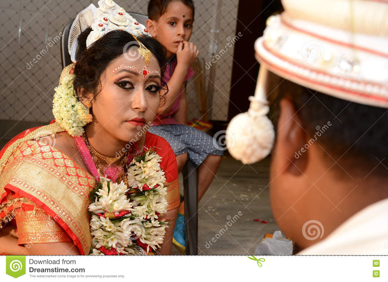 Bengali couple couple are performing religious ceremony in bengali wedding stock photo