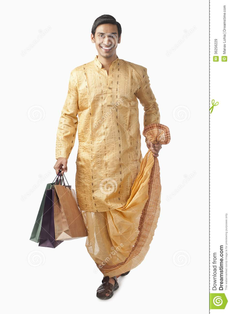 bengali man carrying shopping bags and smiling royalty free stock images