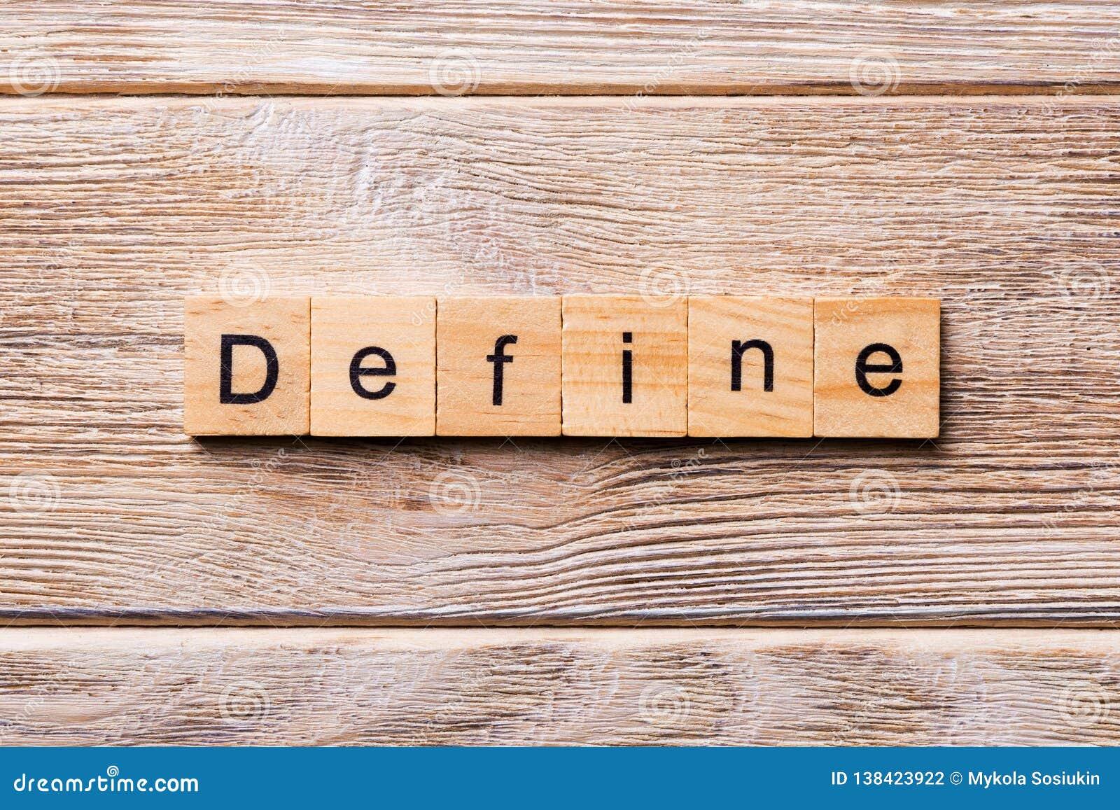 Bepaal woord op houtsnede wordt geschreven die Bepaal tekst op houten lijst voor uw het desing, concept