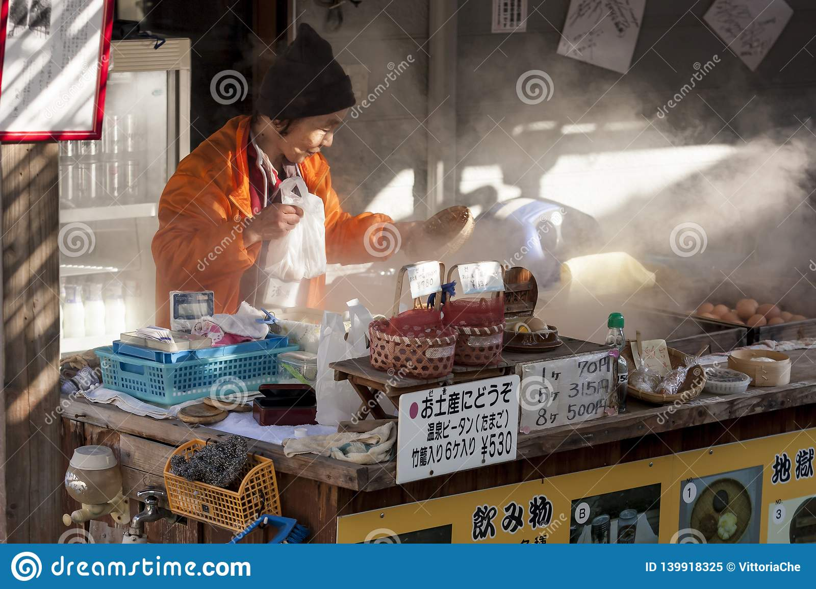 Beppu, Japan. Woman vendor cooking boiled eggs, popular street food in Beppu