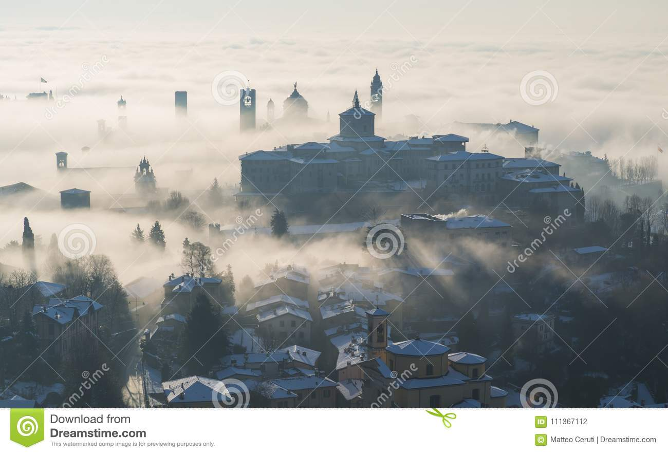 Bergamo, Italy. Lombardy. Amazing landscape of the fog rises from the plains and covers the old town