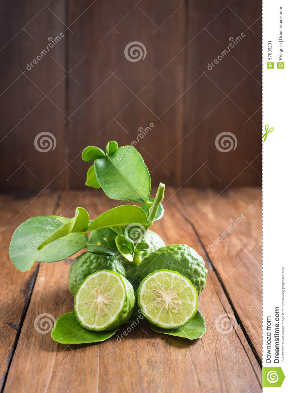 Bergamot with green leafs on wood background
