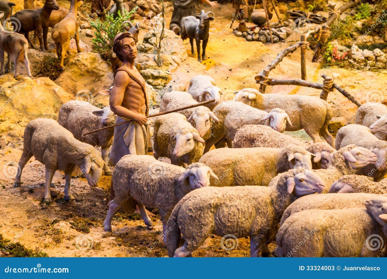 Berger avec un troupeau de moutons