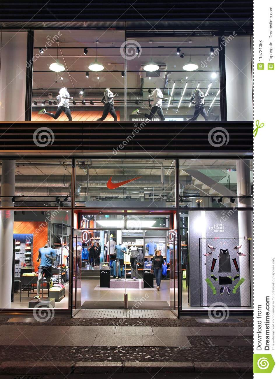 87e22b73d3cc9 BERLIN, GERMANY - AUGUST 25, 2014: People visit Nike store in Berlin. As of  2014 Nike Inc operates some 850 retail sports goods stores worldwide.