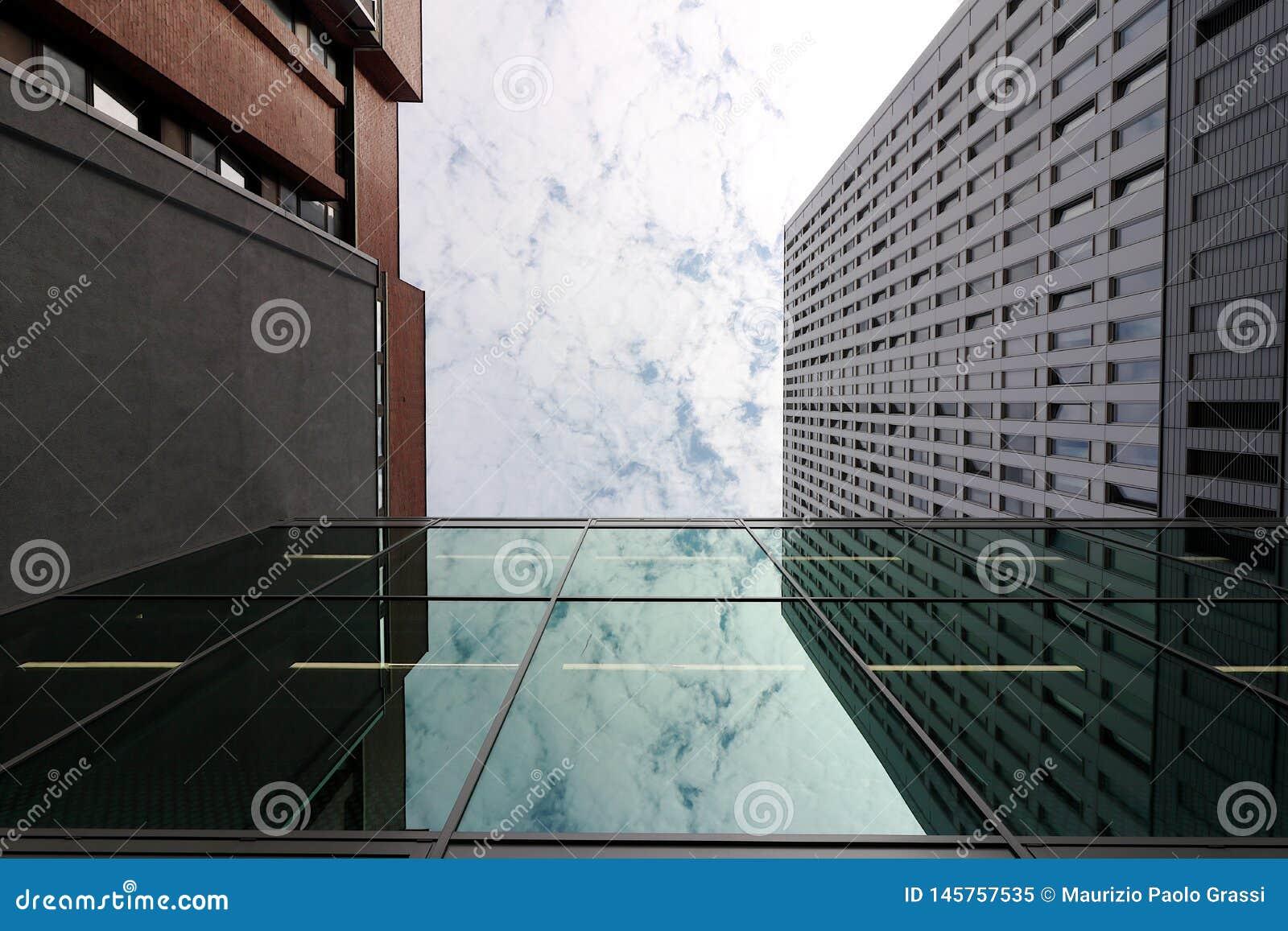Berlin, Germany, 13 June 2018. Modern buildings of the new Berlin. The sky is mirrored in a window