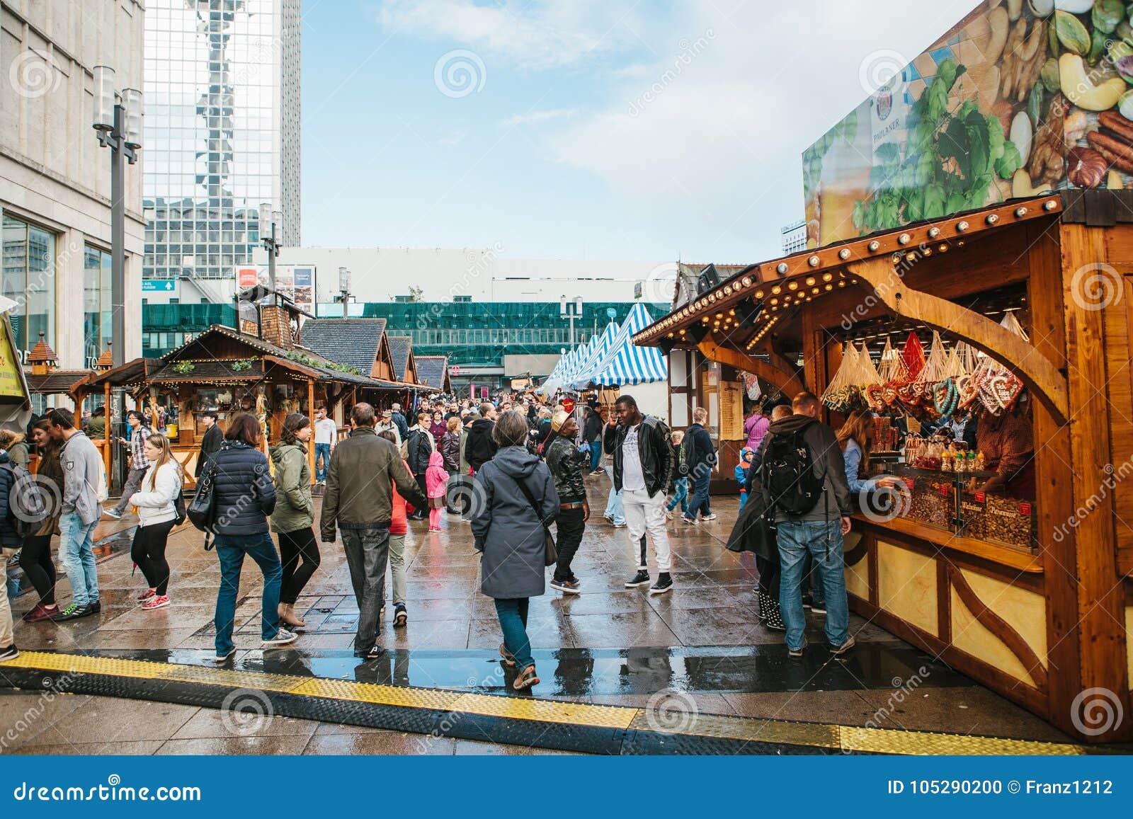 Berlin, October 03, 2017: Celebrating the Oktoberfest. People walk on the street market on the famous Alexanderplatz